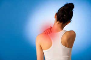 Waman having pain in her neck over blue background